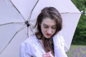 Fashion blogger Veronika Lipar of Brunette From Wall Street staring in makeup story Singing in the Rain wearing bold green and gold eye makeup