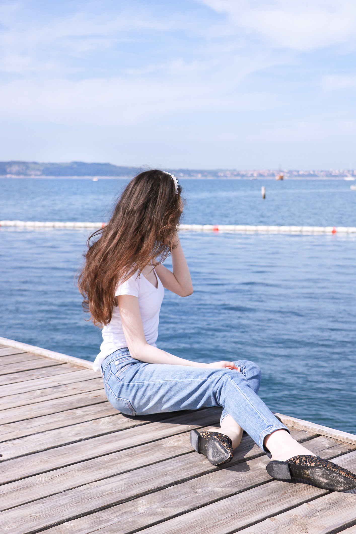 Fashion blogger Veronika Lipar of Brunette From Wall Street sharing how to elevate a casual outfit while by the Adriatic sea