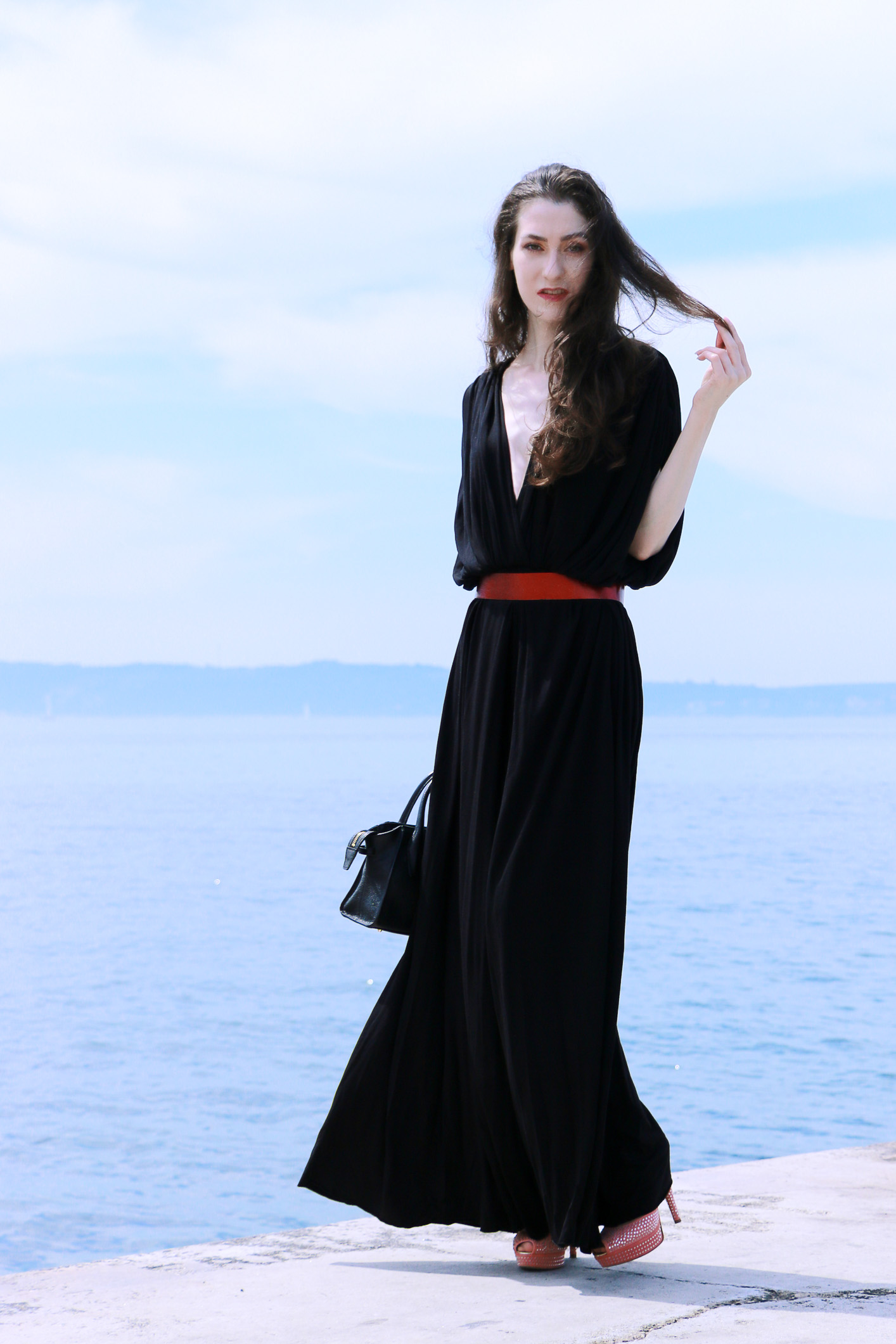 Fashion blogger Veronika Lipar of Brunette From Wall Street sharing how to dress up for a gala event this summer