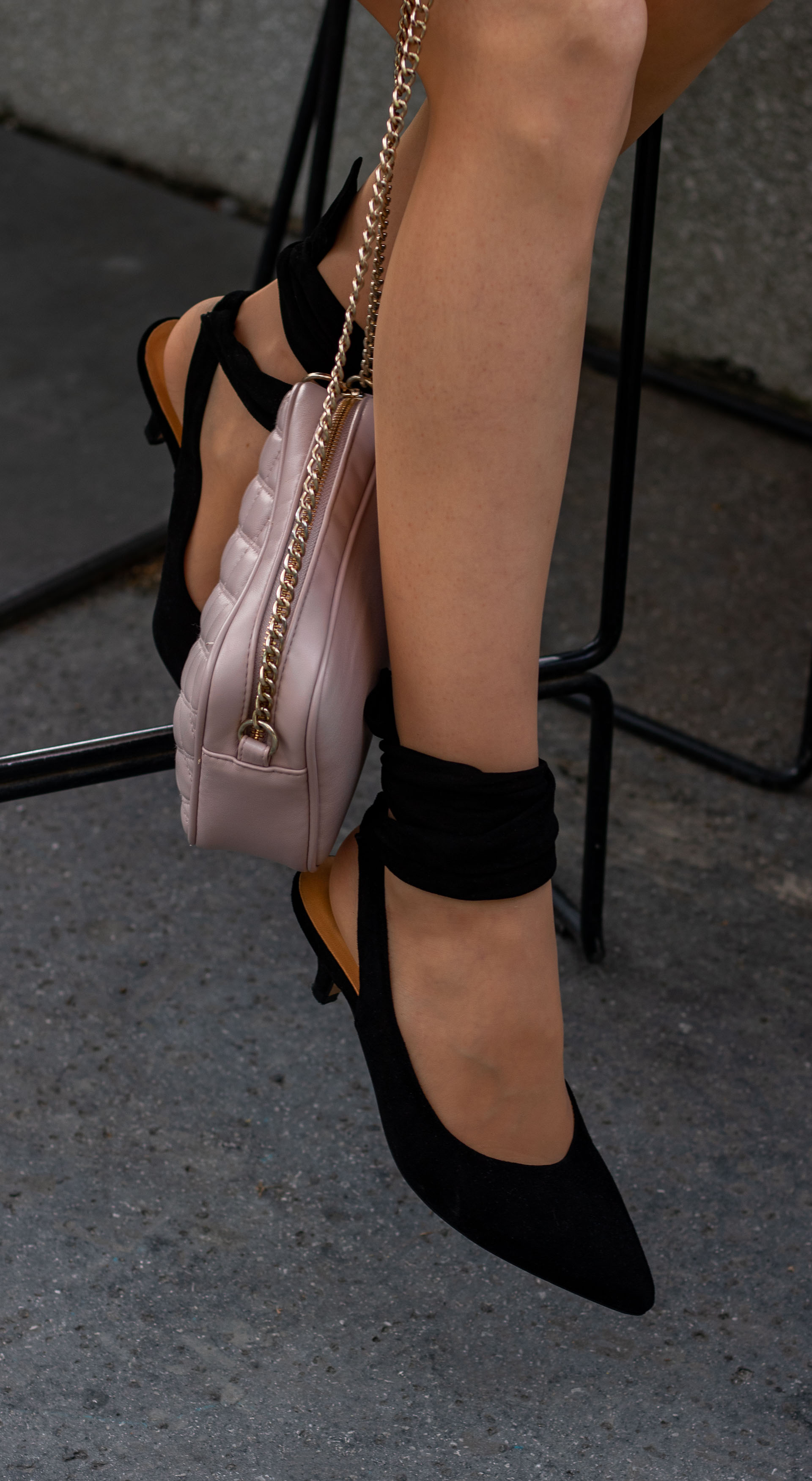 Beautiful Fashion Blogger Veronika Lipar of Brunette from Wall Street wearing Ganni Sabine pumps chain shoulder bag at after work party