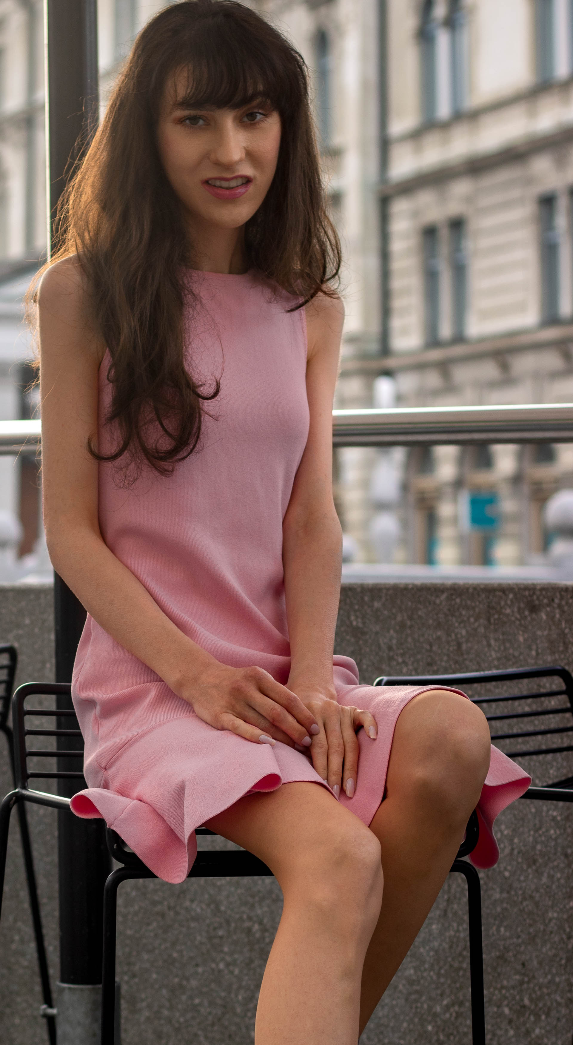 Beautiful Fashion Blogger Veronika Lipar of Brunette from Wall Street wearing peachy pink Superdown cocktail dress for after work party