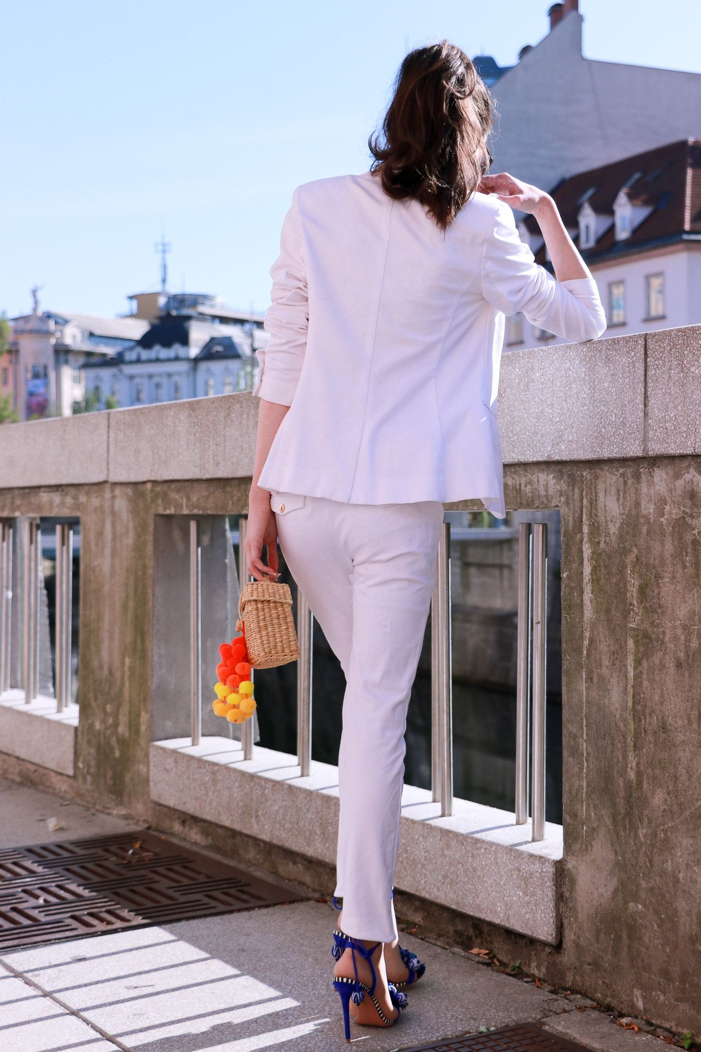 Fashion blogger Veronika Lipar of Brunette From Wall Street sharing her white cocktail party outfit