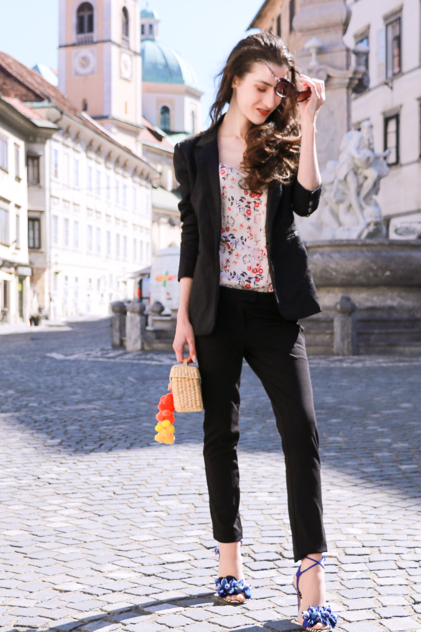 Fashion blogger Veronika Lipar of Brunette From Wall Street sharing how to style all black suit this summer