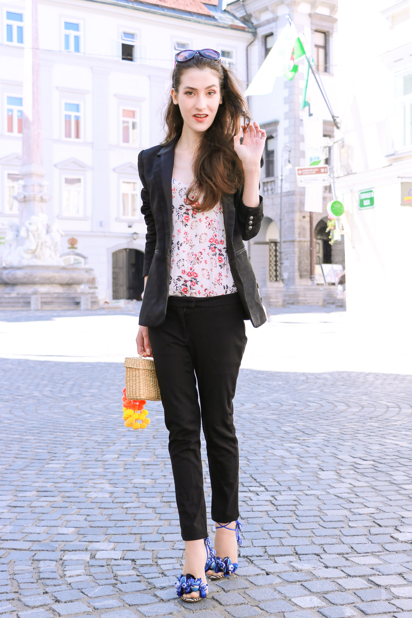 Fashion blogger Veronika Lipar of Brunette From Wall Street in a modern black suit