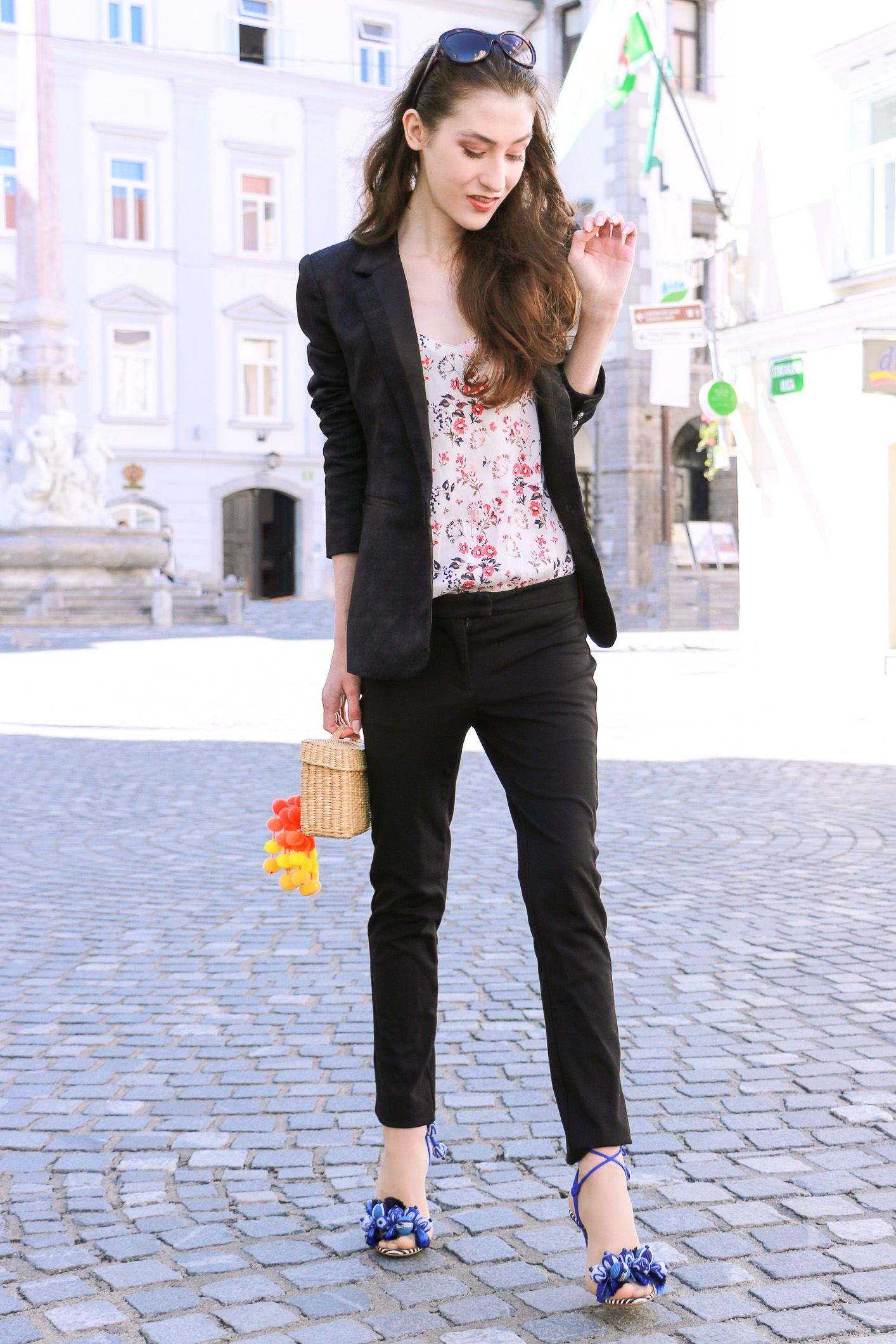 Fashion blogger Veronika Lipar of Brunette From Wall Street sharing fashionable business casual style in all black trouser suit