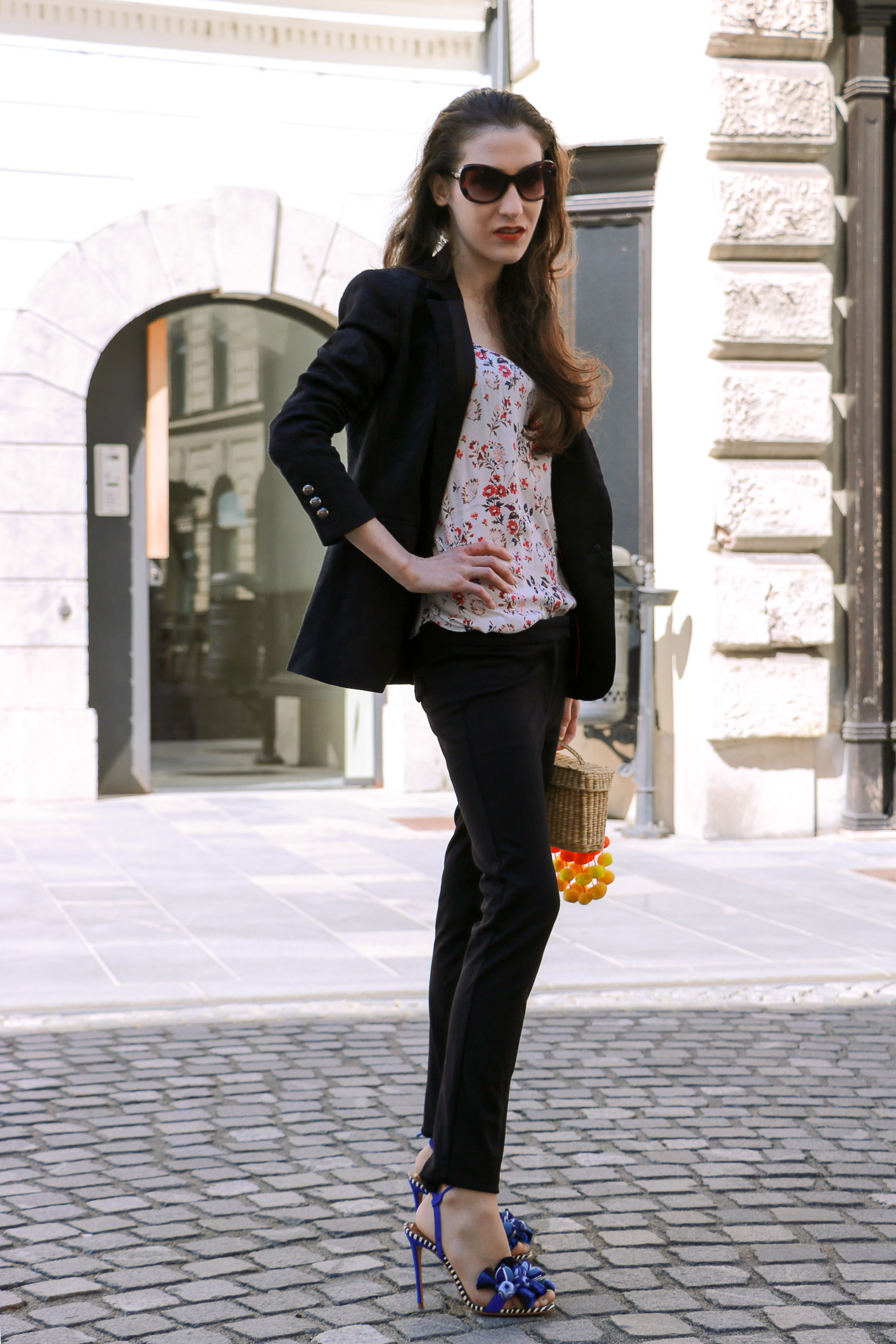 Fashion blogger Veronika Lipar of Brunette From Wall Street sharing fashionable business casual black outfit
