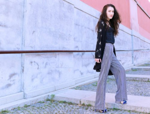 Fashion blogger Veronika Lipar of Brunette From Wall Street sharing how to wear long layers this summer in shirtdress and wide-leg pants