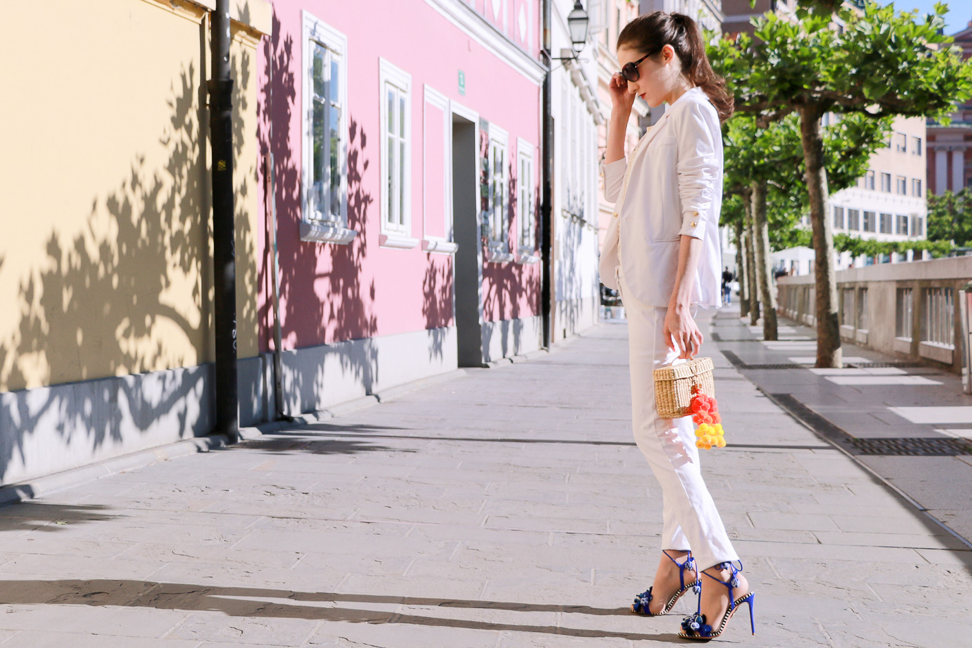 Fashion blogger Veronika Lipar of Brunette From Wall Street sharing fashionable business casual style in all white trouser suit