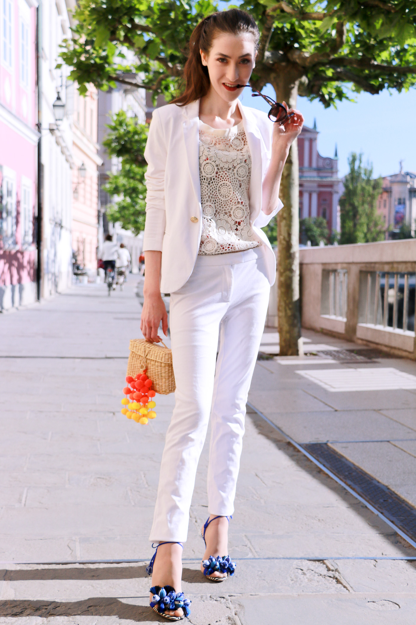 Fashion blogger Veronika Lipar of Brunette From Wall Street wearing all white pantsuit on the streets