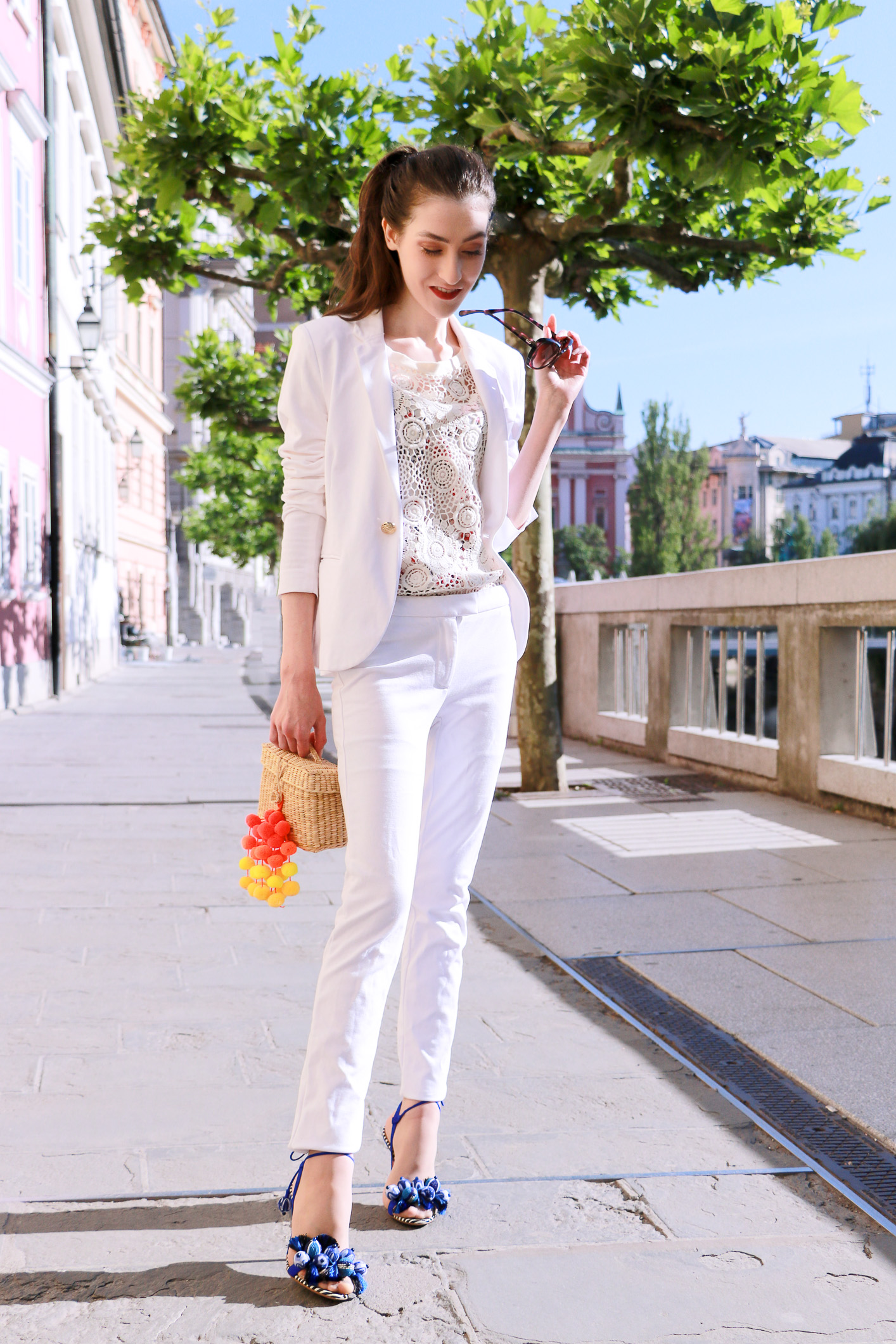 Fashion blogger Veronika Lipar of Brunette From Wall Street in white suit and tasselled sandals
