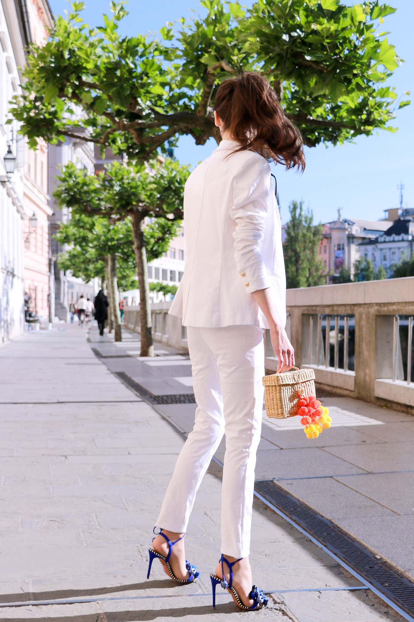 Fashion blogger Veronika Lipar of Brunette From Wall Street sharing fashionable business casual white outfit