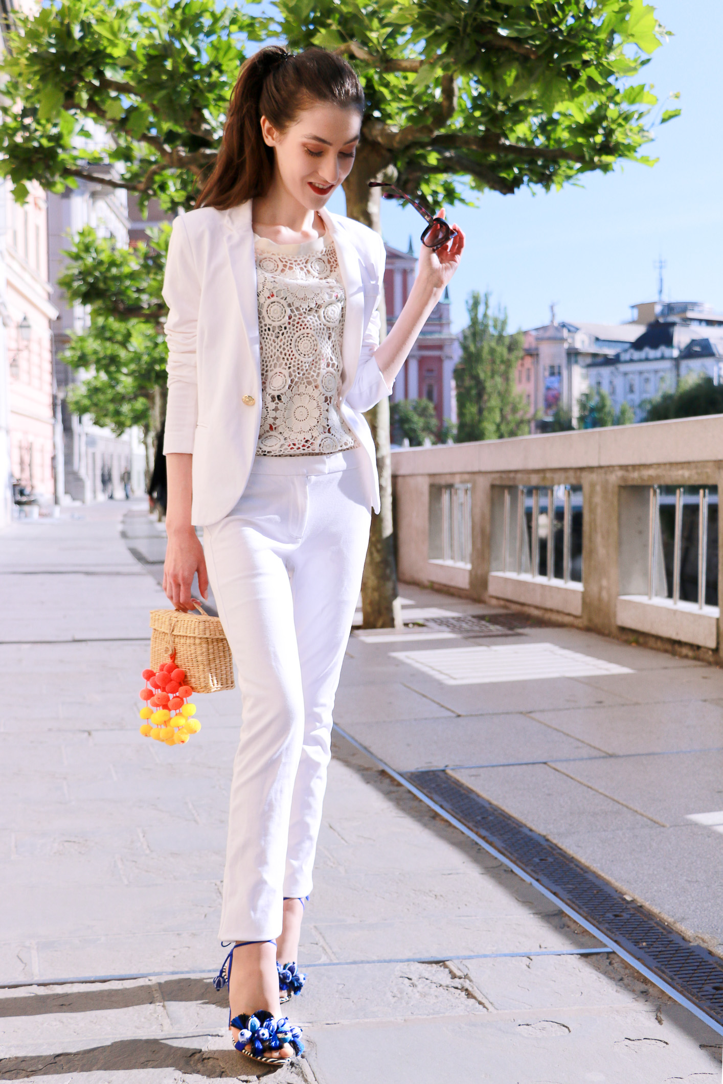 Fashion blogger Veronika Lipar of Brunette From Wall Street sharing how to all white suit to the office this summer