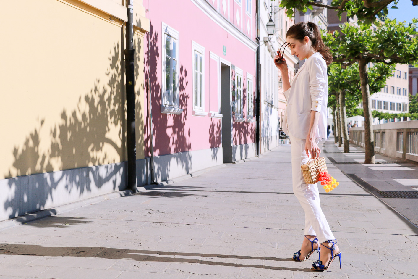 Fashion blogger Veronika Lipar of Brunette From Wall Street on modern white suit