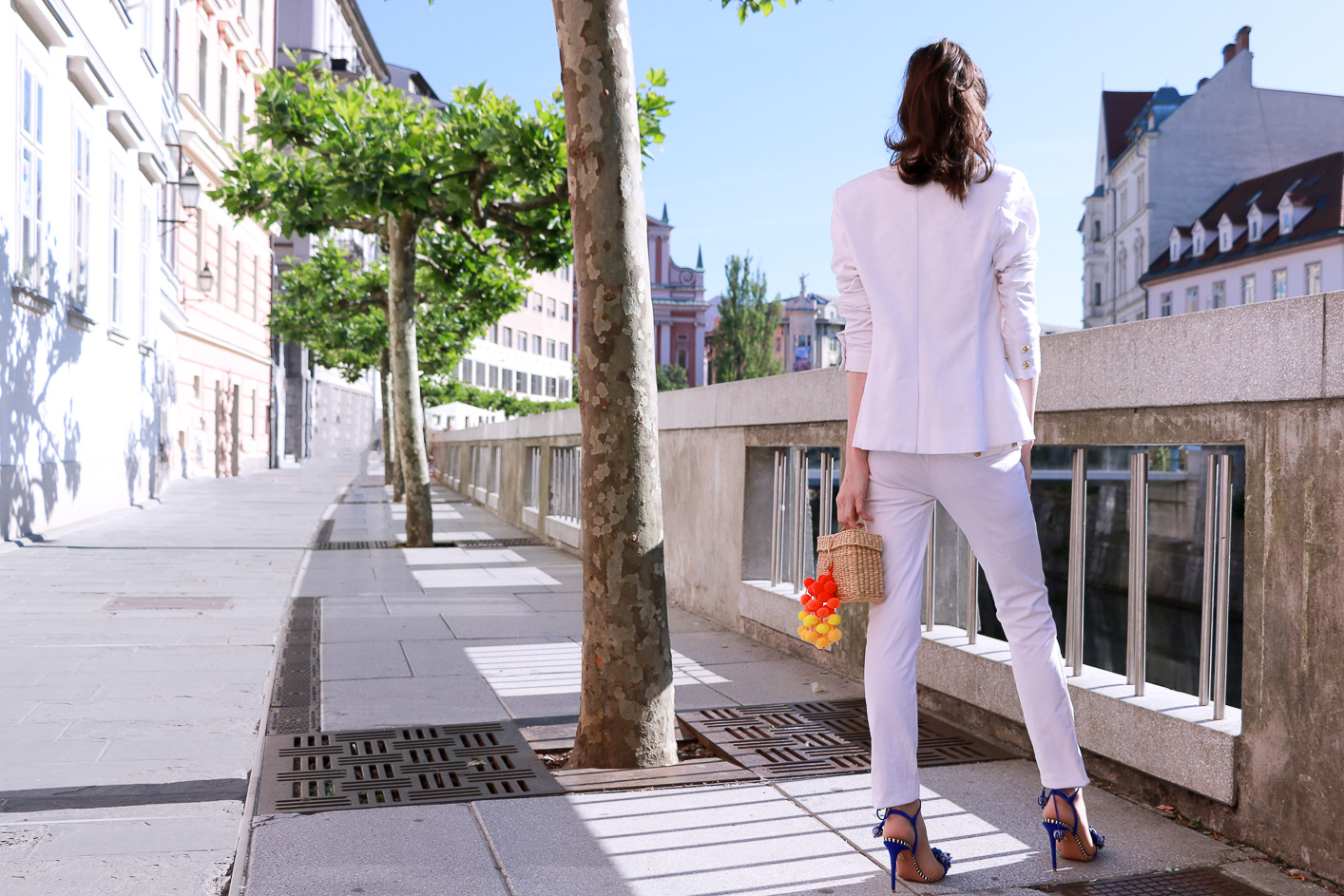 Fashion blogger Veronika Lipar of Brunette From Wall Street sharing how to style all white suit this summer