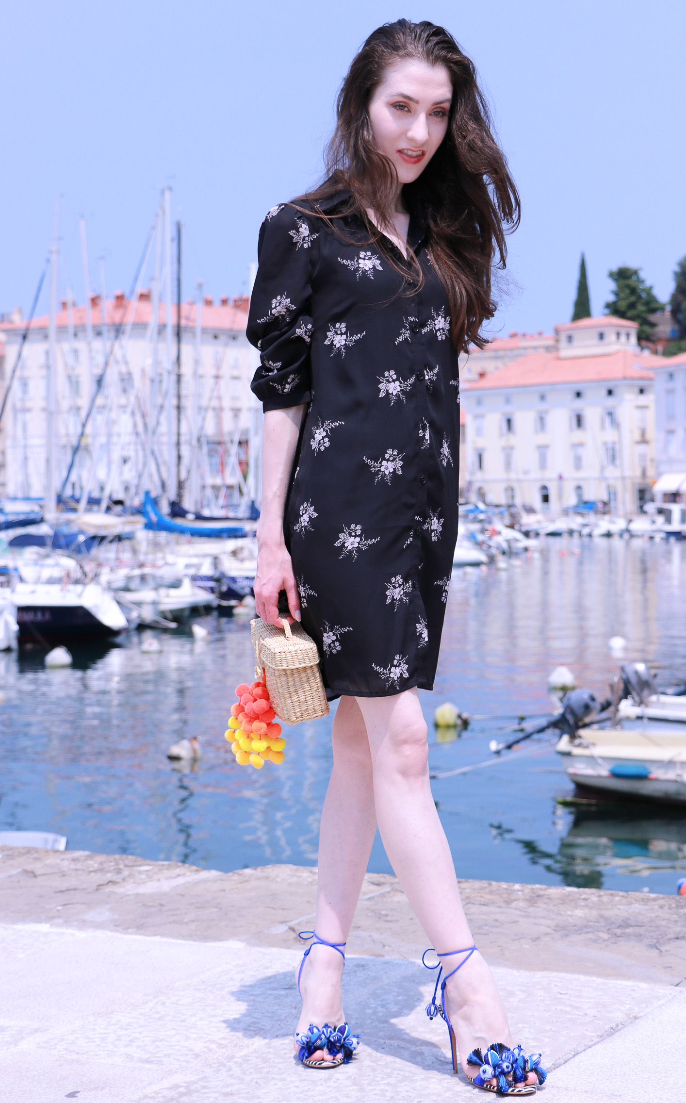 Fashion blogger Veronika Lipar of Brunette From Wall Street on how to wear floral shirt dress this summer