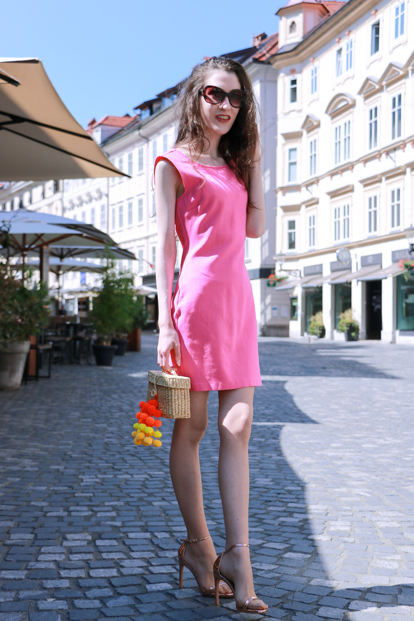 Fashion blogger Veronika Lipar of Brunette From Wall Street sharing how to wear head to toe pink outfit this summer