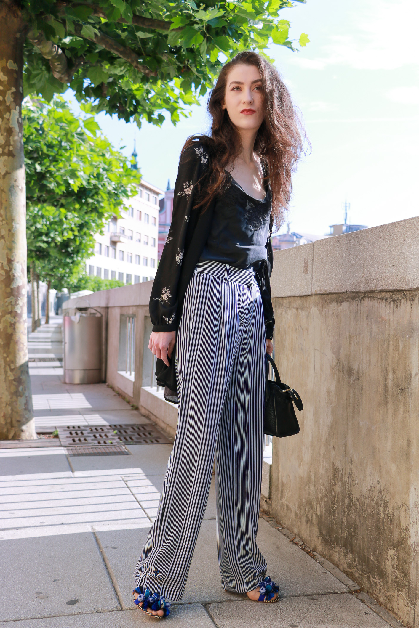Fashion blogger Veronika Lipar of Brunette From Wall Street sharing how to wear kimono this summer