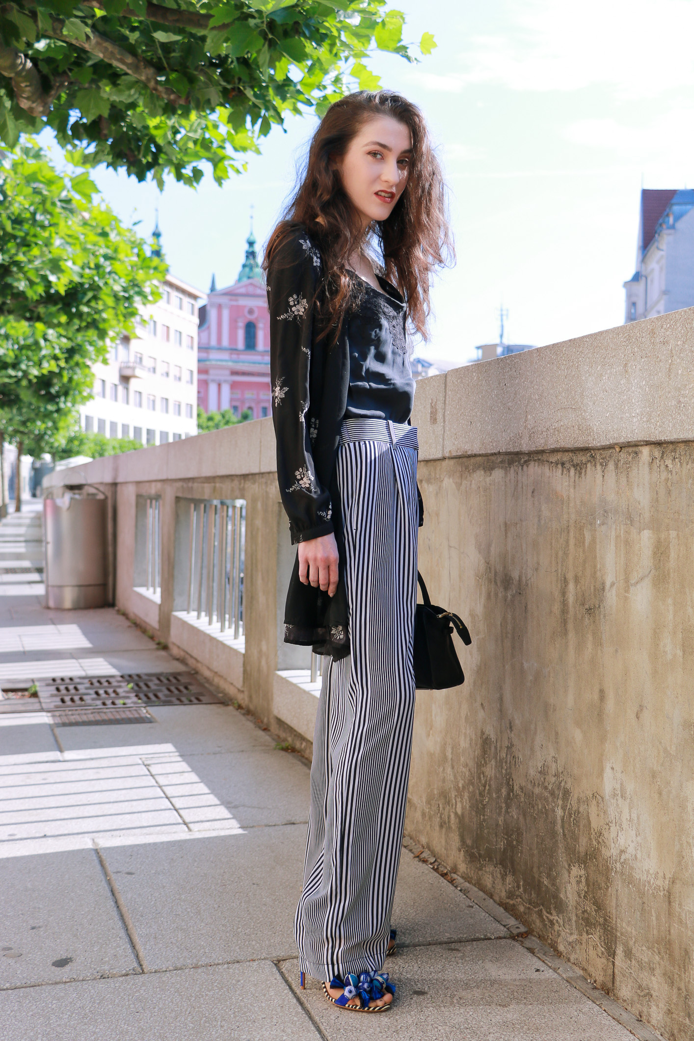 Fashion blogger Veronika Lipar of Brunette From Wall Street sharing how to do layering this summer wearing dark floral shirt dress and wide-leg trousers