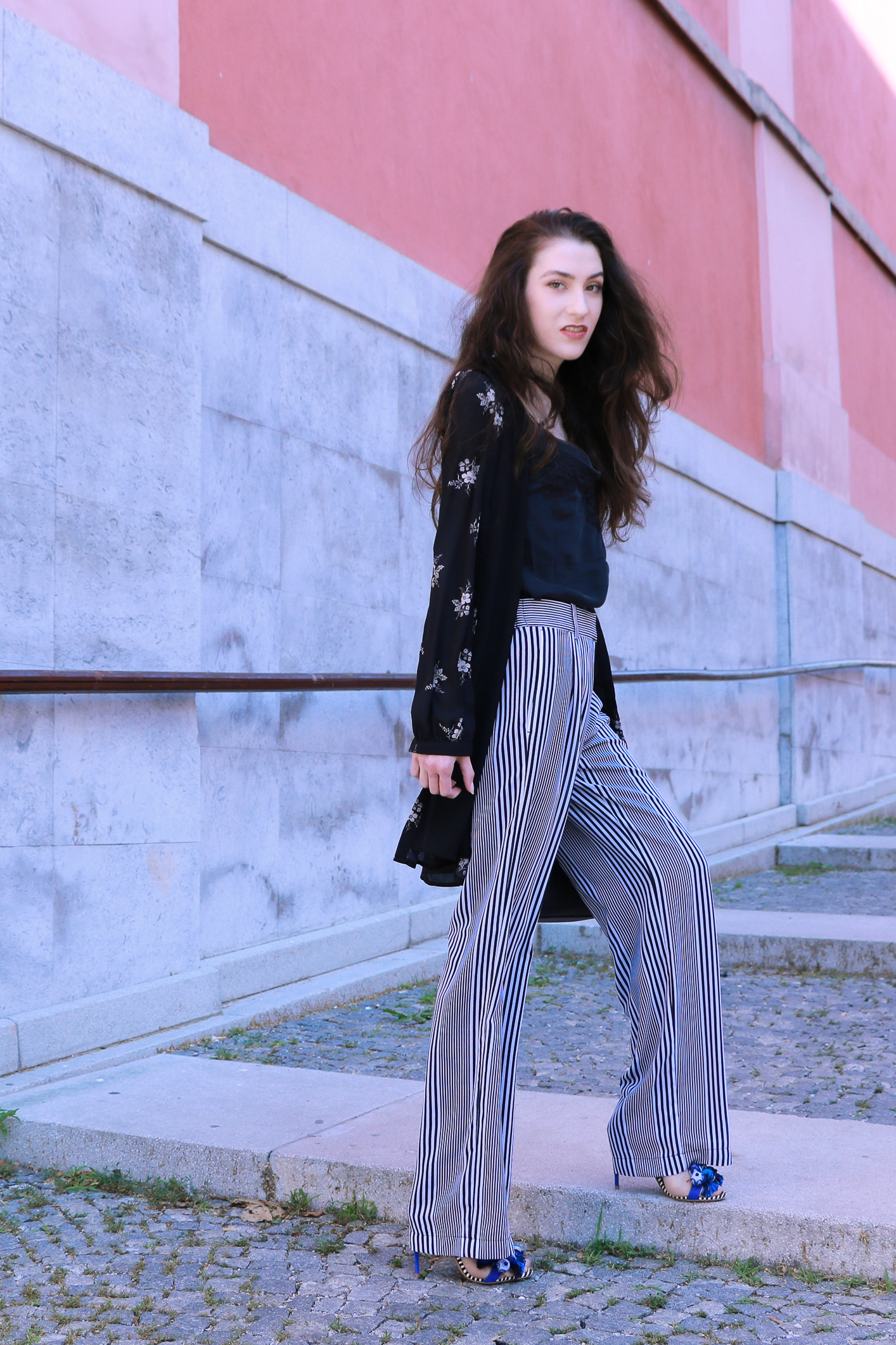 Fashion blogger Veronika Lipar of Brunette From Wall Street sharing how to wear layers this summer in shirtdress and wide-leg pants