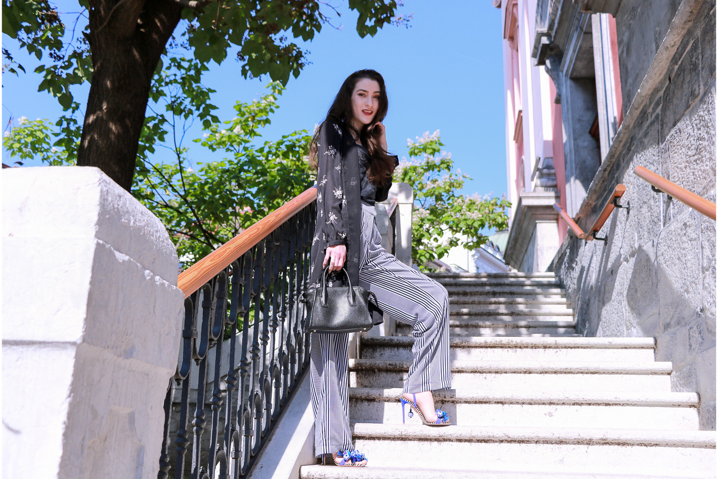 Fashion blogger Veronika Lipar of Brunette From Wall Street in Ljubljana wearing long layers this summer in shirtdress and wide-leg pants