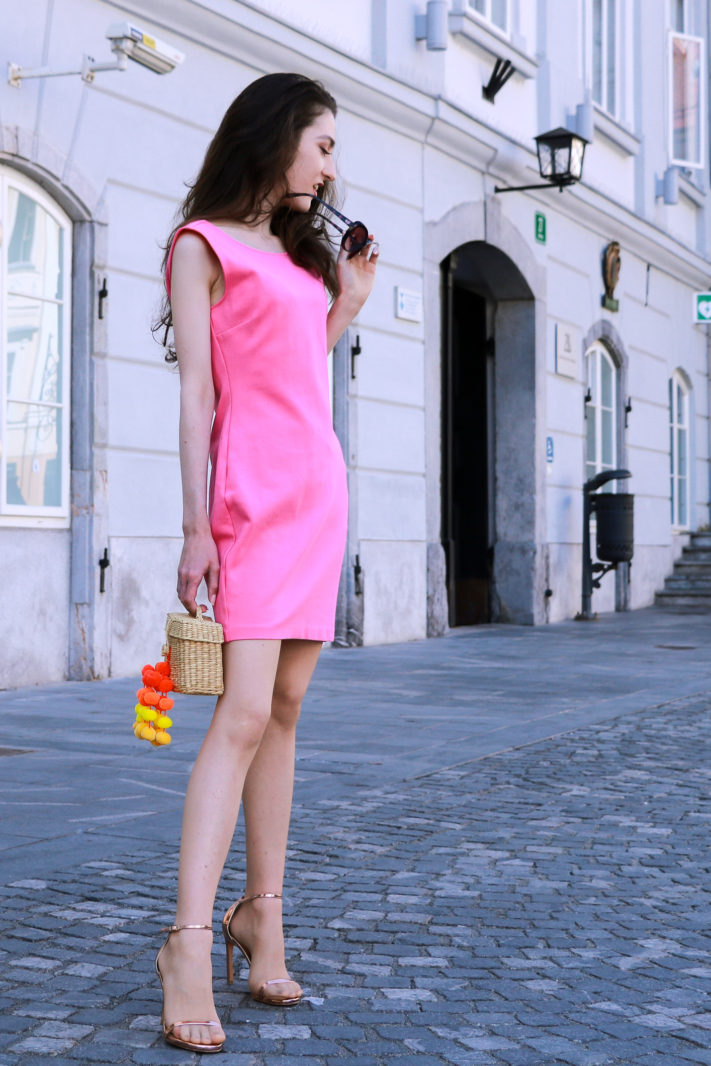 Fashion blogger Veronika Lipar of Brunette From Wall Street sharing how to style head to toe pink outfit this summer