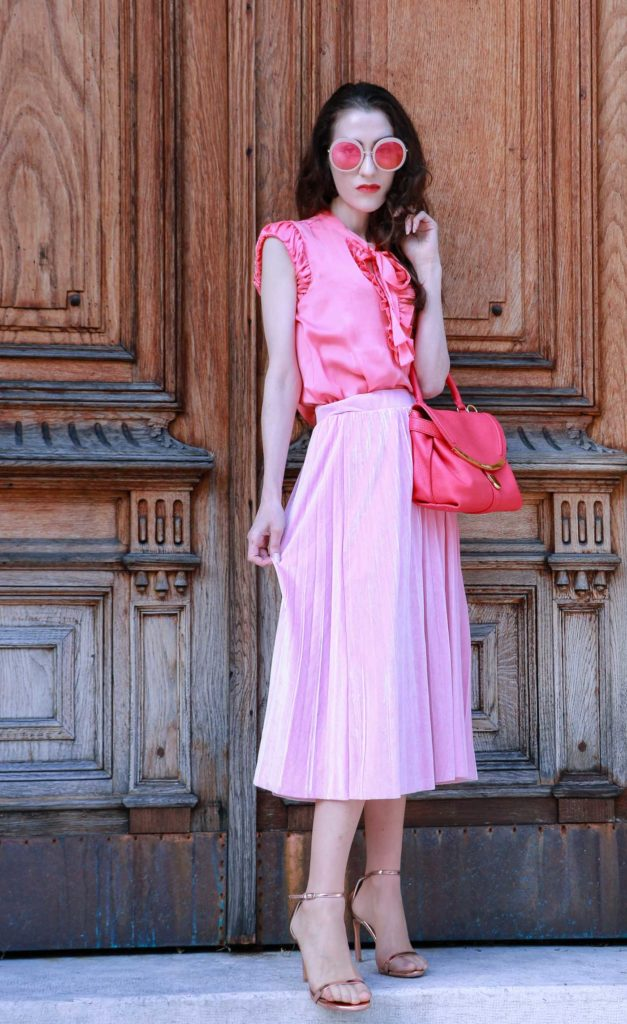 Fashion Blogger Veronika Lipar of Brunette from Wall Street wearing pink clothes and metallic shoes while standing at the door