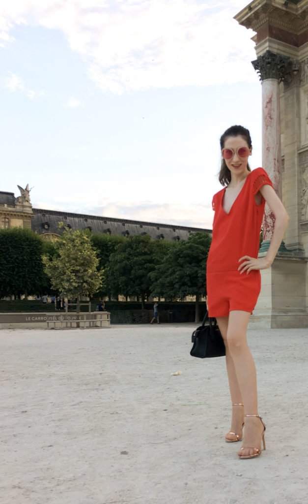 Fashion Blogger Veronika Lipar of Brunette from Wall Street wearing red outfit in Paris during Paris Haute Couture Week