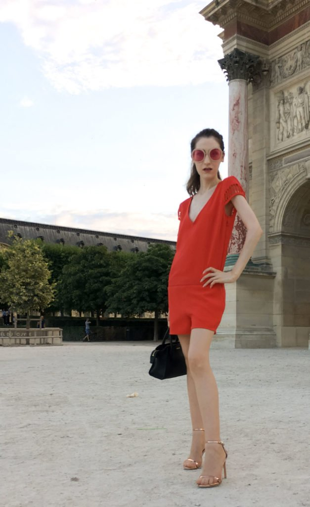 Fashion Blogger Veronika Lipar of Brunette from Wall Street wearing red romper in Paris during Paris Haute Couture Week