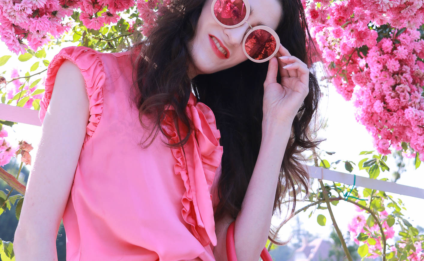 Fashion Blogger Veronika Lipar of Brunette from Wall Street wearing bold red lipstick, glowing makeup, pink round sunglasses
