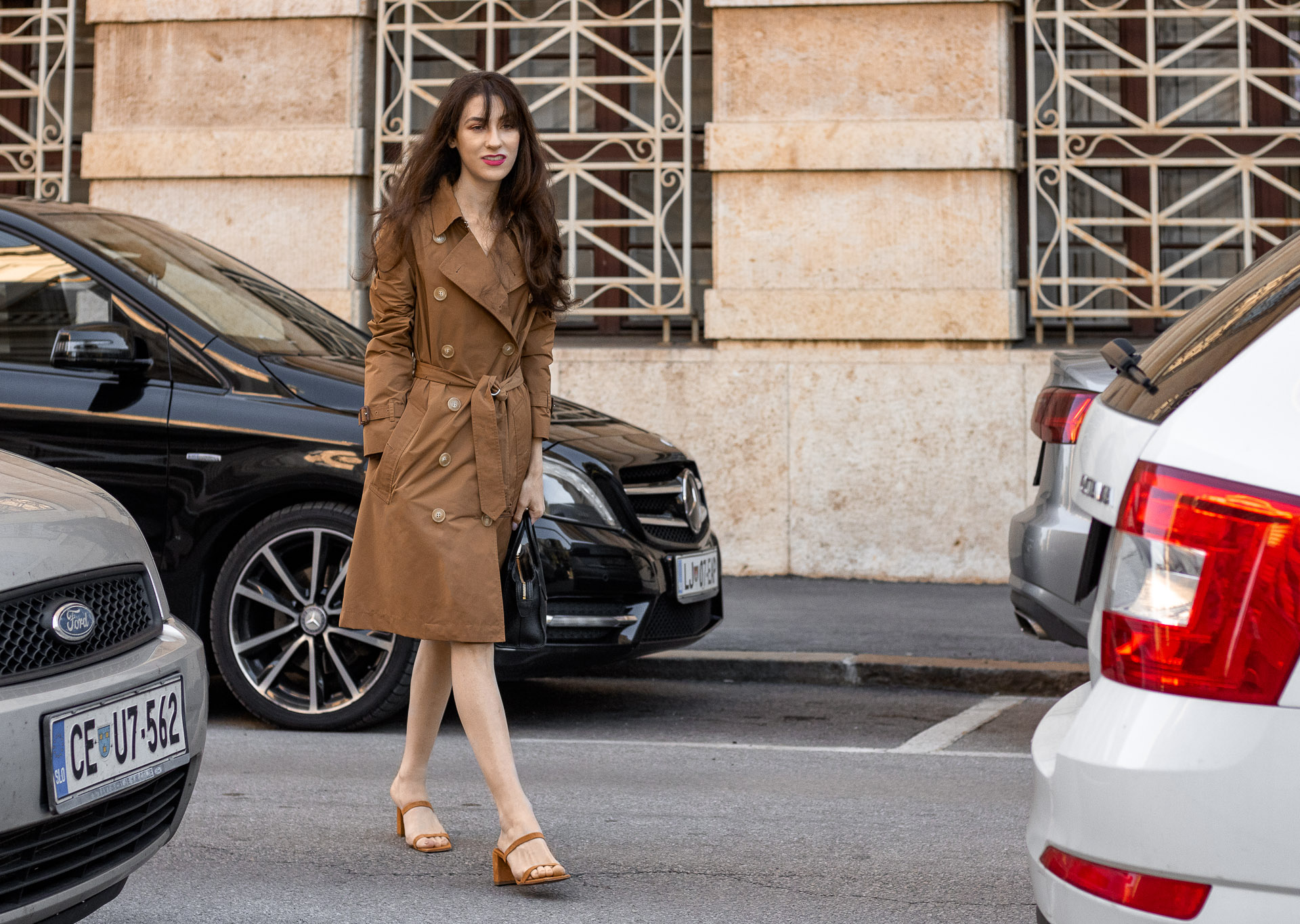 Must follow Fashion Blogger Veronika Lipar of Brunette from Wall Street wearing Burberry trench coat By Far Tanya sandals on summer rainy day