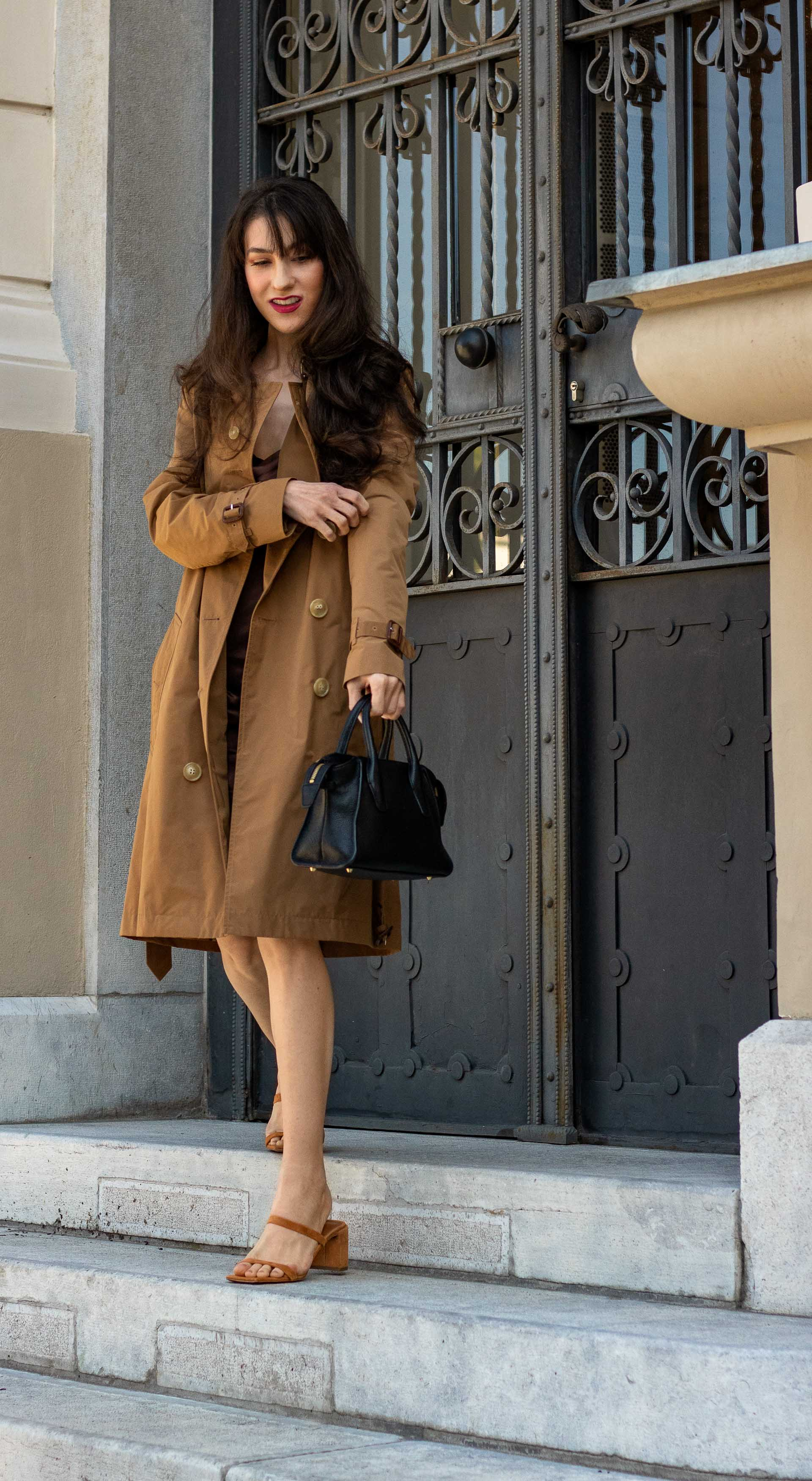 Must follow Fashion Blogger Veronika Lipar of Brunette from Wall Street wearing Burberry trench coat By Far Tanya sandals brown slip dress on summer rainy day