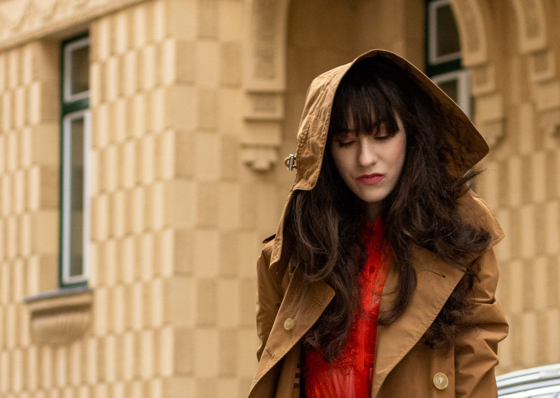Must follow Fashion Blogger Veronika Lipar of Brunette from Wall Street wearing Burberry trench coat with hood Self-Portrait orange dress on summer rainy day