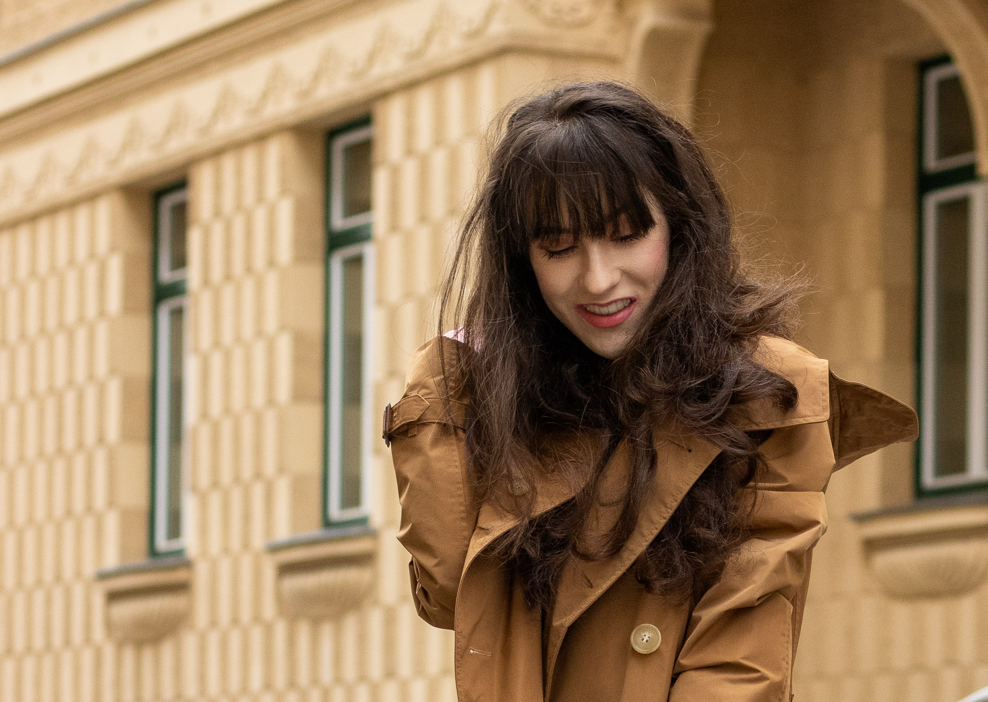 Must follow Fashion Blogger Veronika Lipar of Brunette from Wall Street wearing Burberry trench coat with hood on summer rainy day