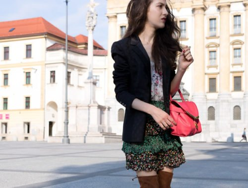 Fashion Blogger Veronika Lipar of Brunette from Wall Street wearing Stuart Weizman brown over the knee boots, mini ruffled boho skirt, black blazer and See by Chloe pink top handle bag