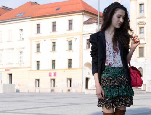 Fashion Blogger Veronika Lipar of Brunette from Wall Street wearing brown over the knee boots, mini ruffled boho skirt, black blazer and pink top handle bag