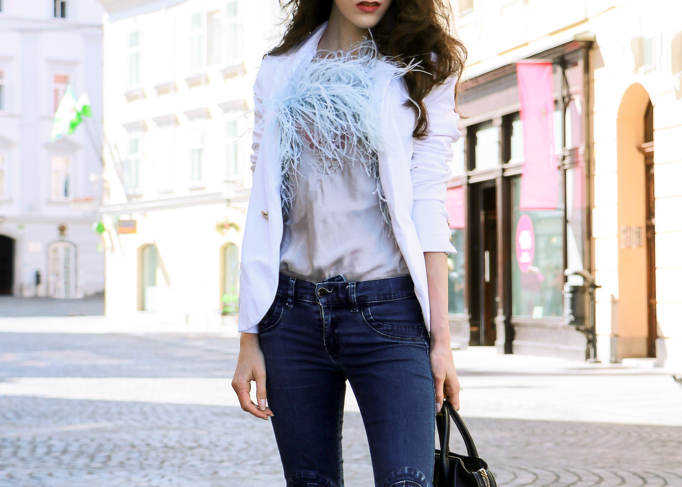Fashion Blogger Veronika Lipar of Brunette from Wall Street on how to wear feathers everyday