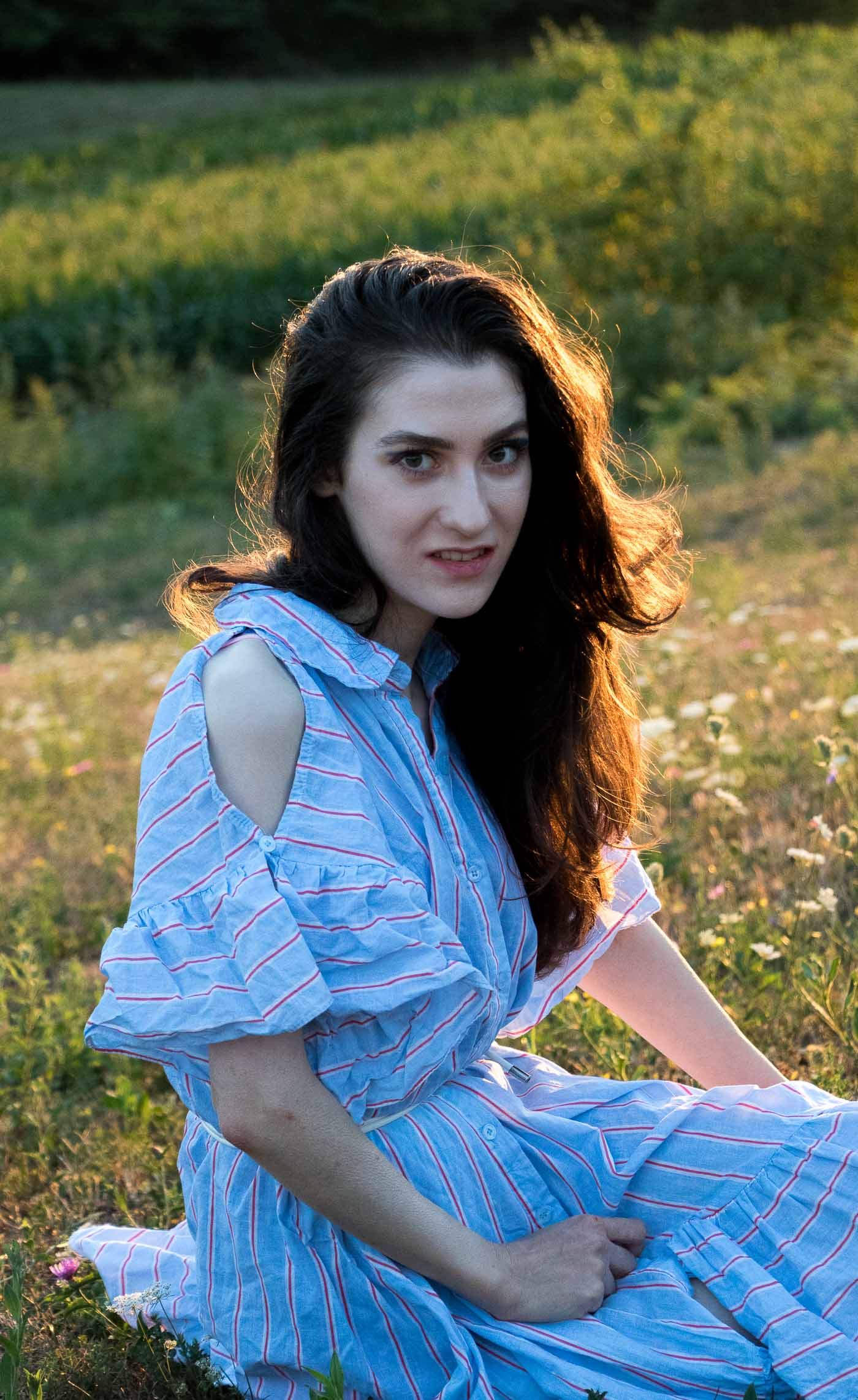 Fashion Blogger Veronika Lipar of Brunette from Wall Street wearing striped ruffled cold shoulder dress and bold eye makeup