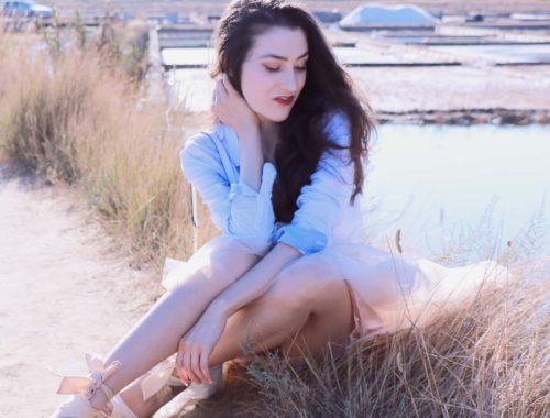 Fashion Blogger Veronika Lipar of Brunette from Wall Street sitting in the burned grass wearing chic tulle skirt