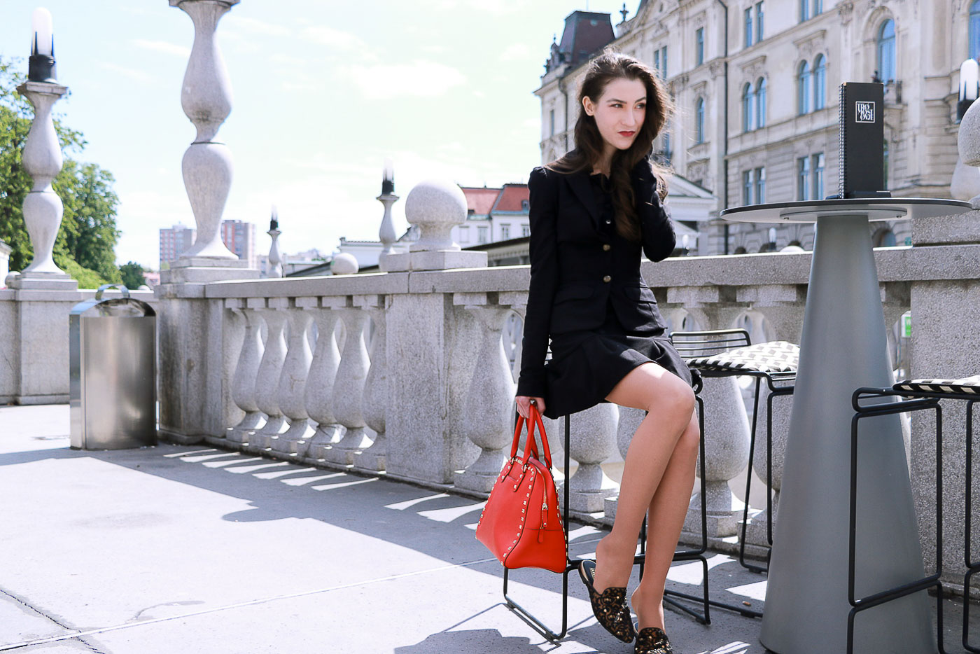 Fashion Blogger Veronika Lipar of Brunette from Wall Street brunching with her girl friends on a fall day dressed in a chic black skirt suit