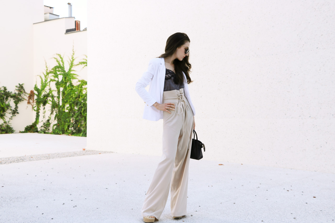 Fashion Blogger Veronika Lipar of Brunette from Wall Street on it pants of the season