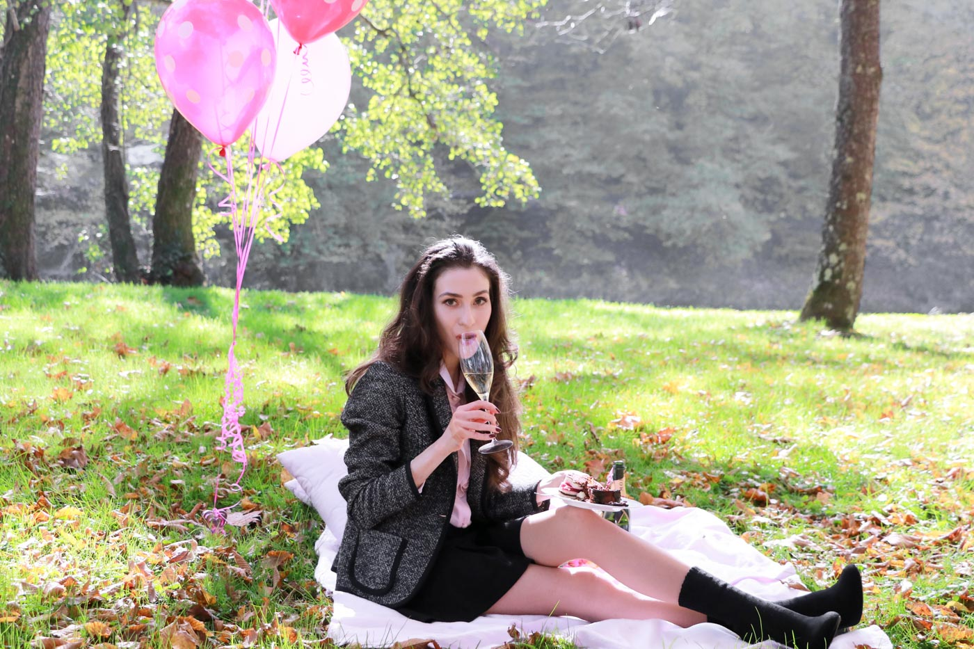Fashion Blogger Veronika Lipar of Brunette from Wall Street drinking champagne