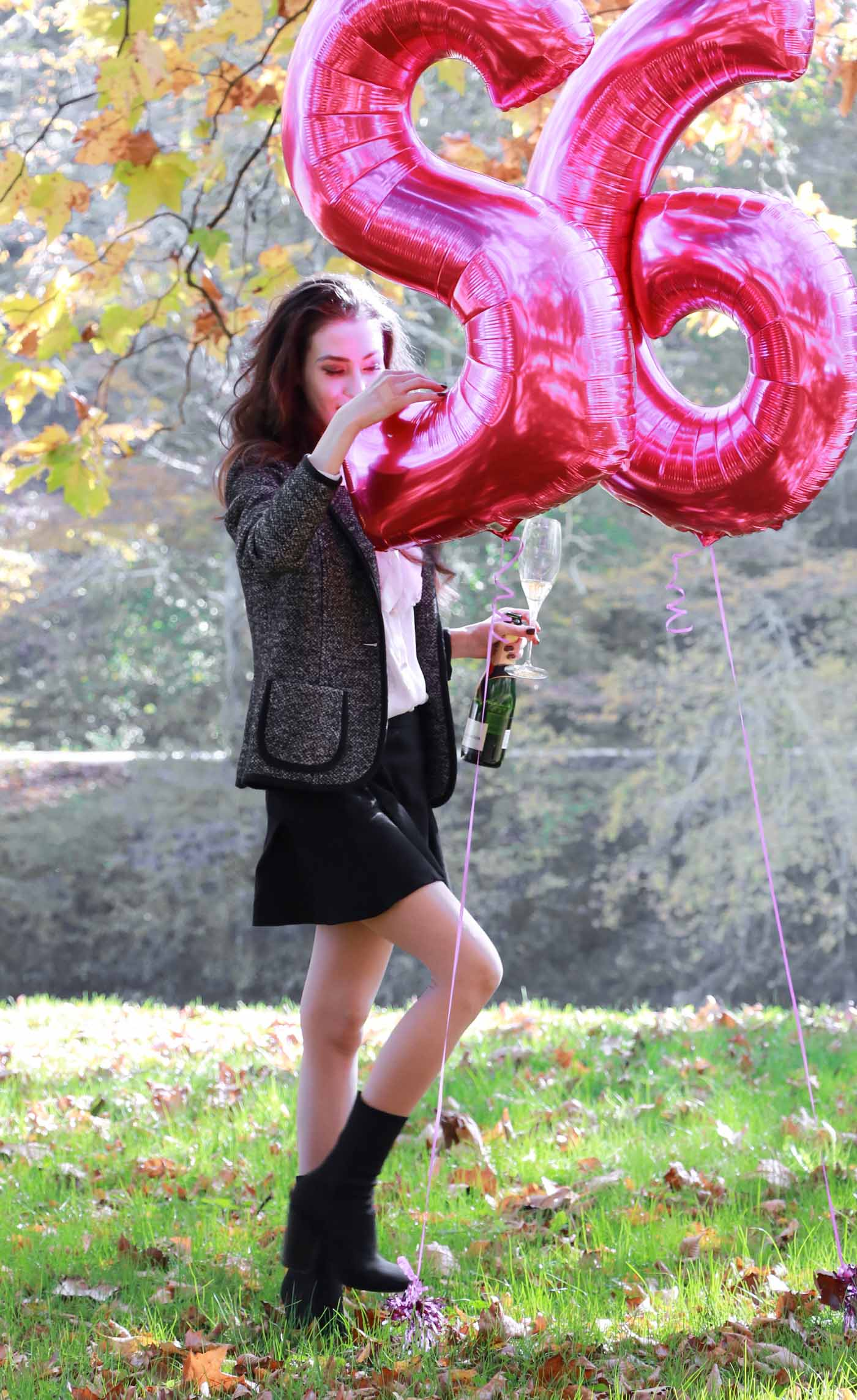 Fashion Blogger Veronika Lipar of Brunette from Wall Street playing with the helium foil pink balloons
