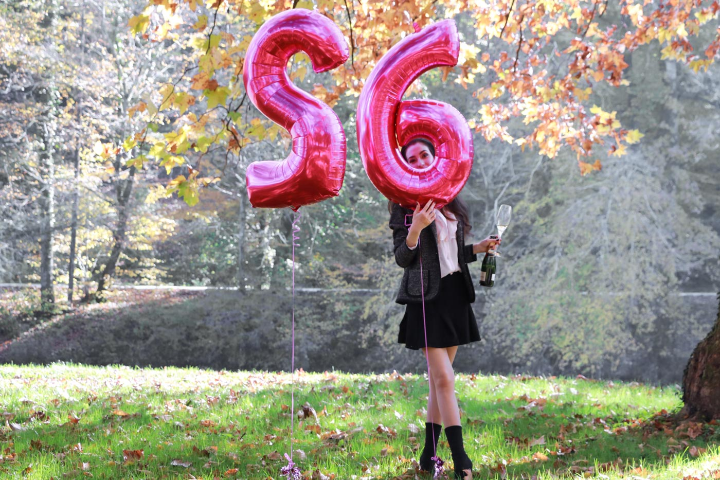 Fashion Blogger Veronika Lipar of Brunette from Wall Street standing by the helium foil pink balloons
