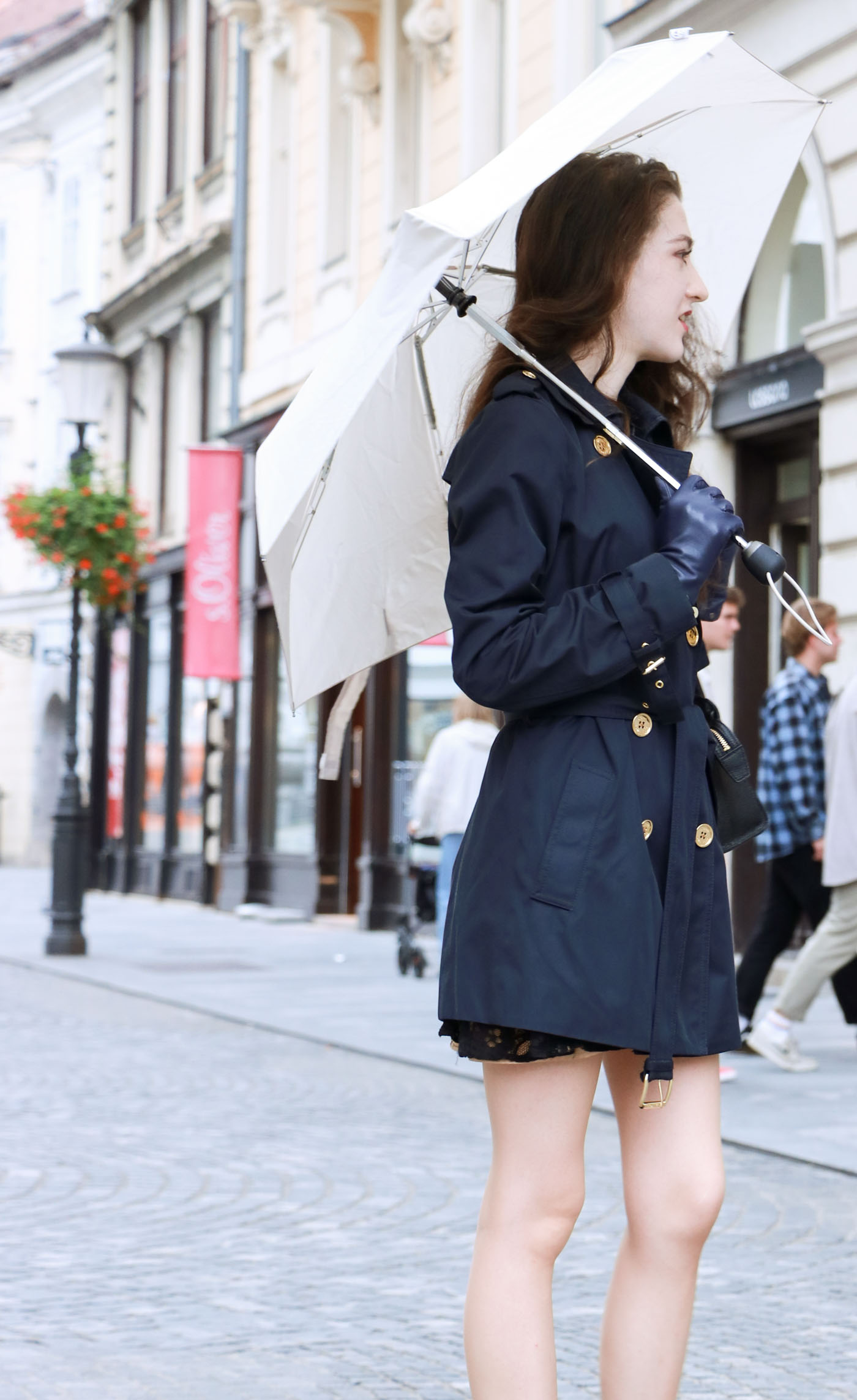 Fashion Blogger Veronika Lipar of Brunette from Wall Street dressed in blue trench coat and ankle boots on a rainy day