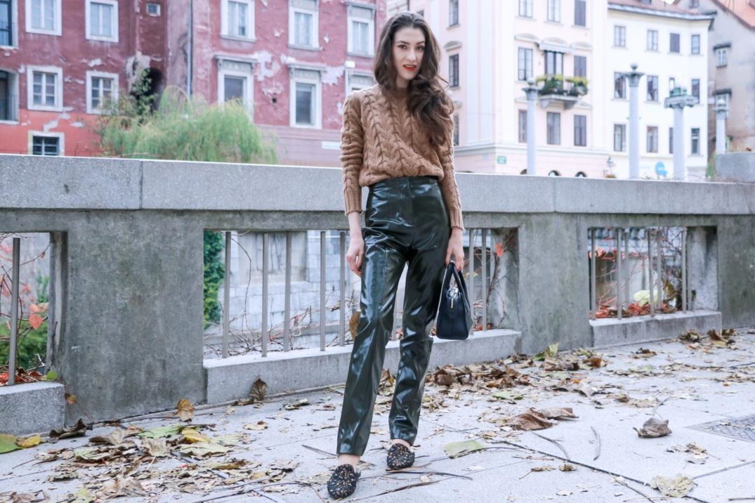 Fashion Blogger Veronika Lipar of Brunette from Wall Street on how to style vinyl pants and simple camel cable knit sweater