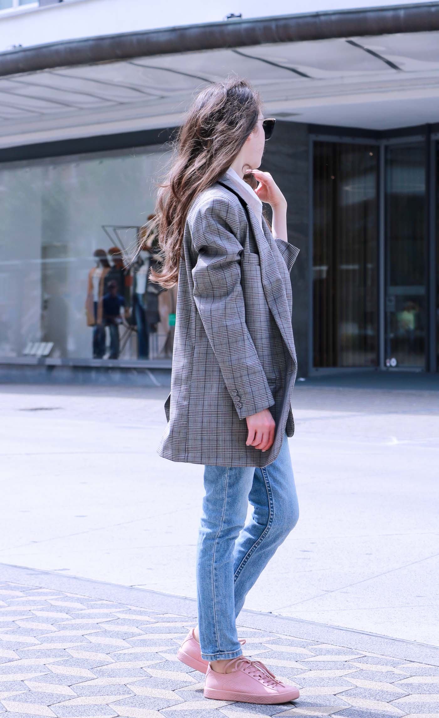 Fashion Blogger Veronika Lipar of Brunette from Wall Street wearing checked oversized boyfriend blazer, mom jeans, and pink sneakers