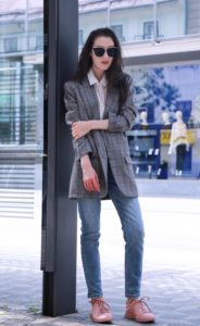 Fashion Blogger Veronika Lipar of Brunette from Wall Street standing on the bus station