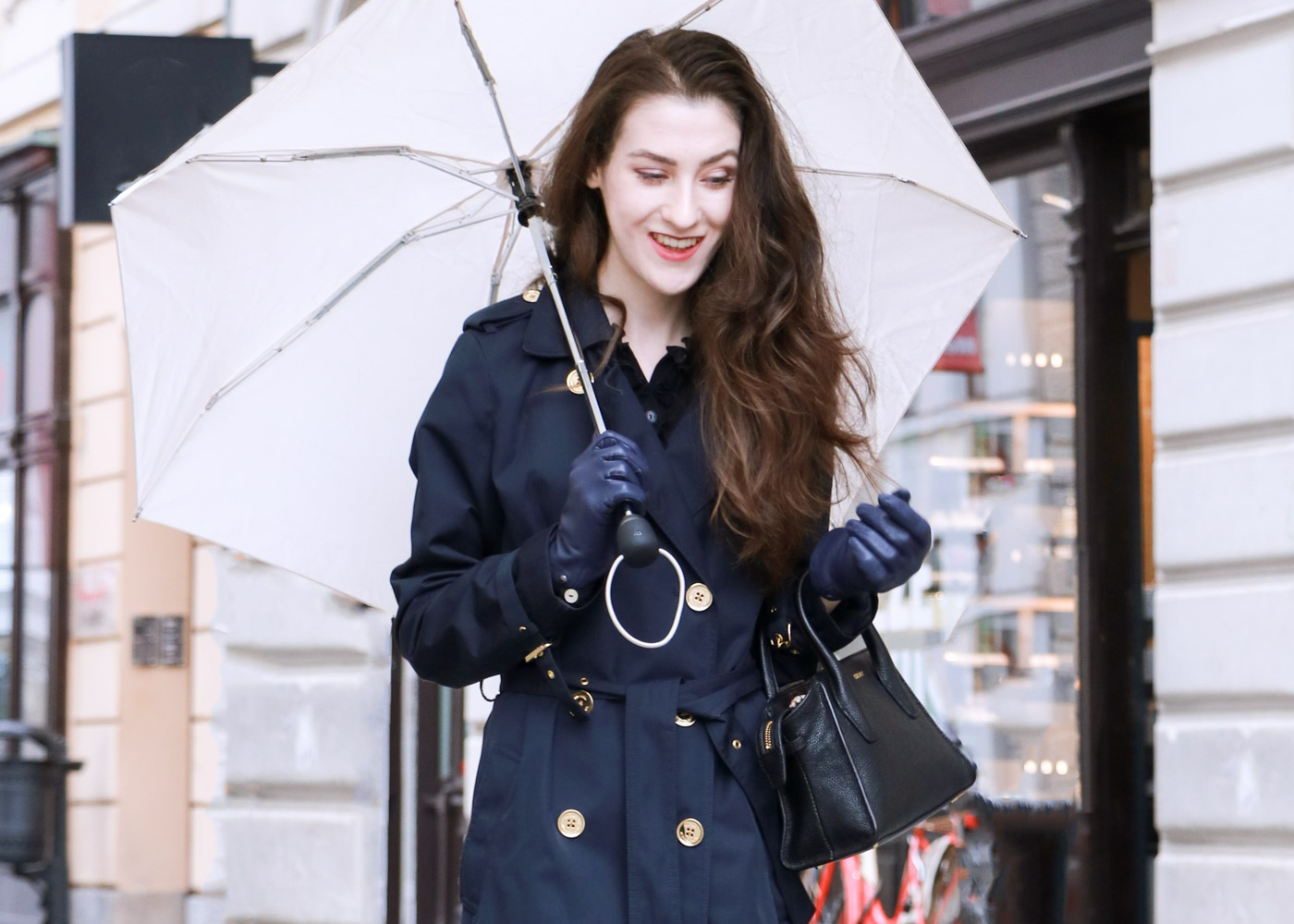 Fashion Blogger Veronika Lipar of Brunette from Wall Street wearing blue trench coat and black sock booties this fall when it rains