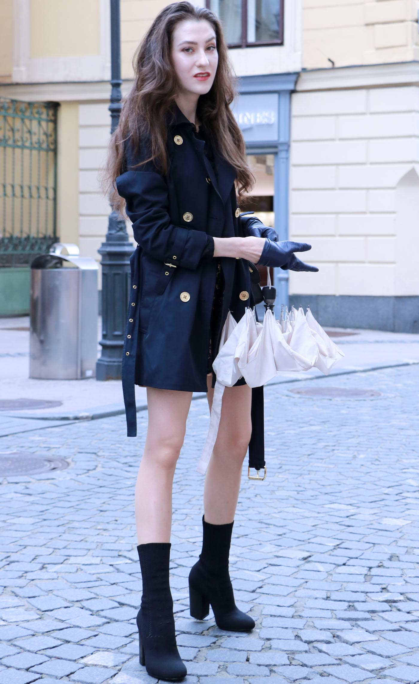 Fashion Blogger Veronika Lipar of Brunette from Wall Street dressed in blue trench coat and black sock booties on a rainy day