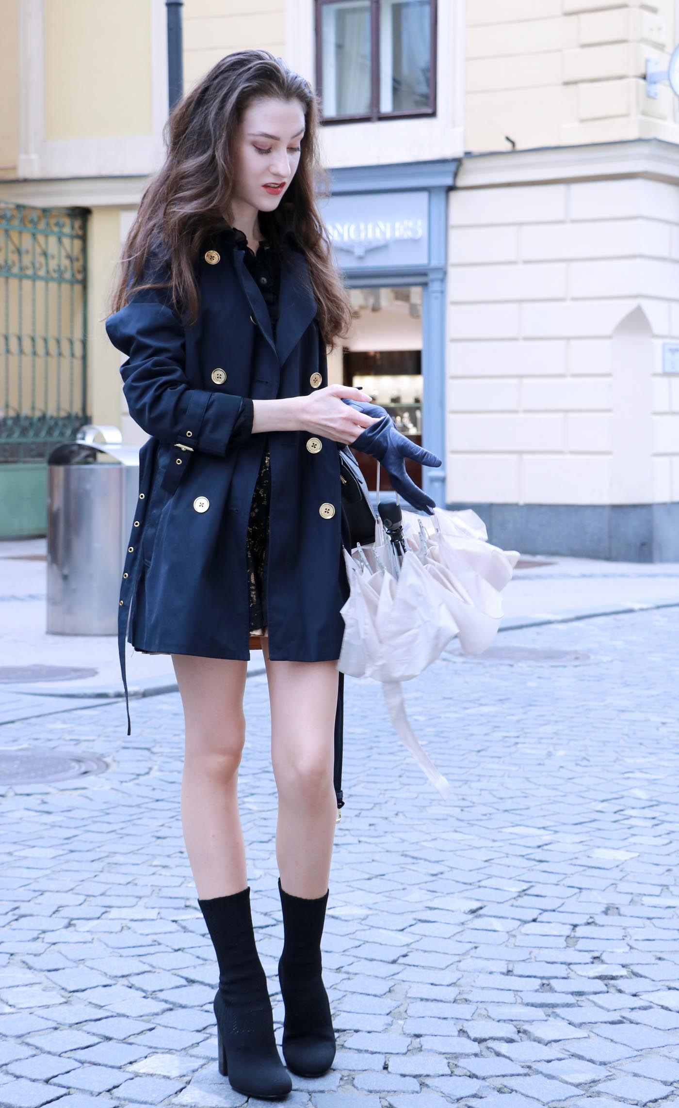 Fashion Blogger Veronika Lipar of Brunette from Wall Street dressed in blue trench coat and ankle booties on a rainy day